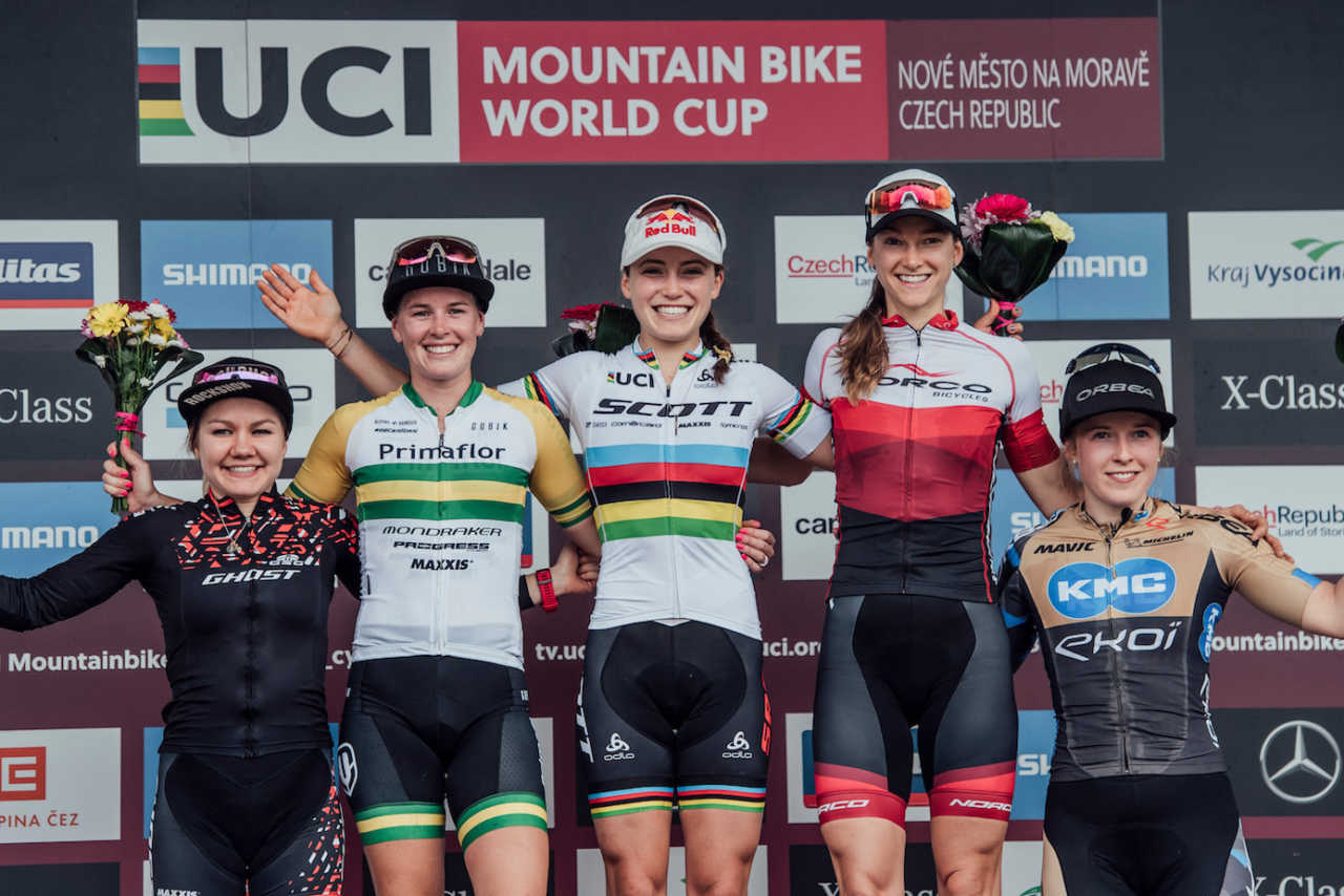 From left: Sina Frei, Rebecca McConnell, Kate Courtney, Haley Smith and Malene Degn stand on the podium at UCI XCO World Cup in Nove Mesto na Morave, Czech Republic on May 26th, 2019