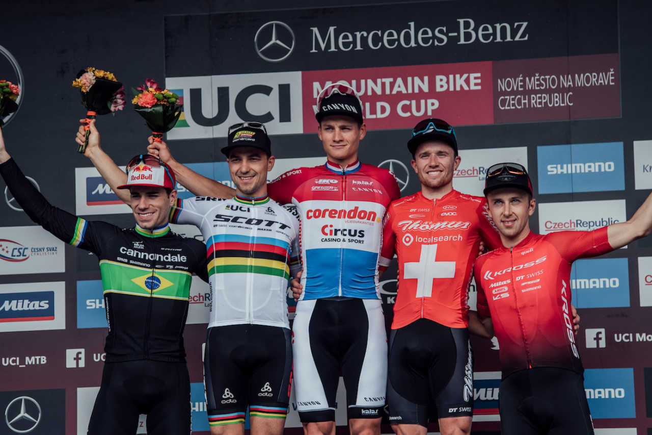 Henrique Avancini, Nino Schurter, Mathieu van der Poel, Mathias Flueckiger, Ondrej Cink stand on the podium at UCI XCO World Cup in Nove Mesto na Morave, Czech Republic on May 26th, 2019