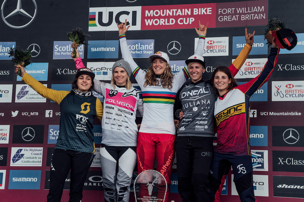 Marine Cabirou, Tracey Hannah, Rachel Atherton, Nina Hoffmann, Veronika Widmann stand on the podium at UCI DH World Cup in Fort William, Great Britain on June 2nd, 2019