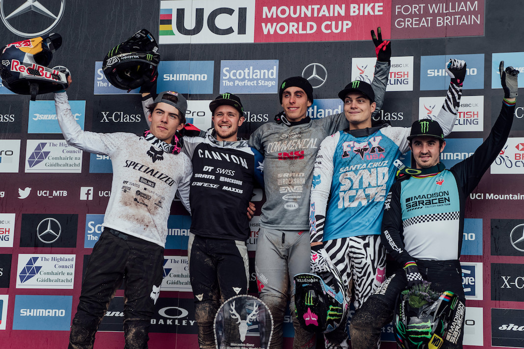 Finn Iles, Troy Brosnan, Amaury Pierron, Loris Vergier, Danny Hart stand on the podium at UCI DH World Cup in Fort William, Great Britain on June 2nd, 2019