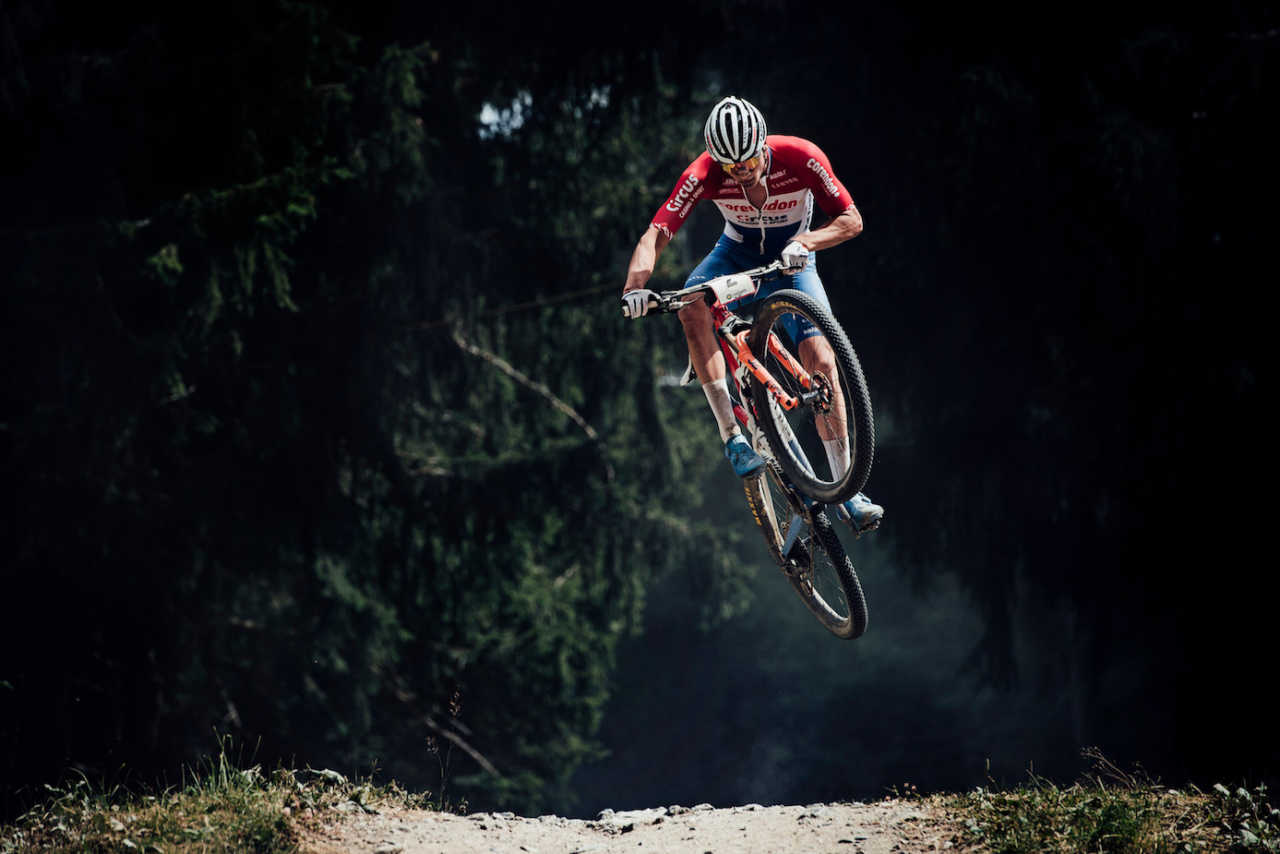 Mathieu van der Poel Kate Courtney at the Les Gets World Cup cross country mountain bike race in France on 14th July 2019.