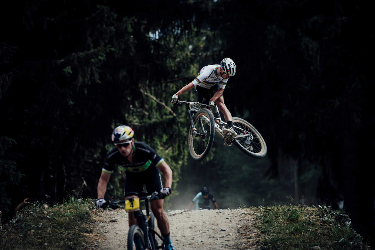 Nino Schurter and Henrique Avancini at the Les Gets World Cup cross country mountain bike race in France on 14th July 2019.