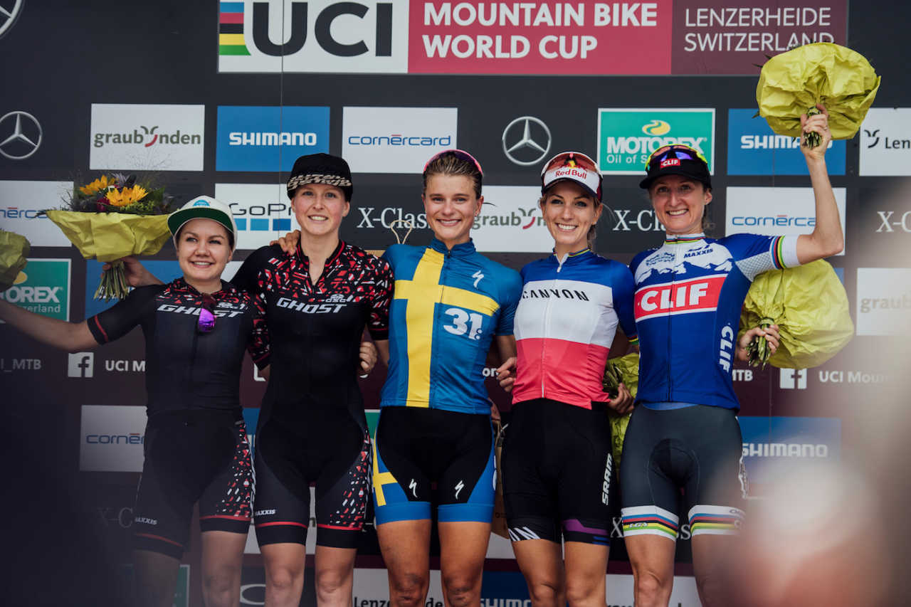 Competitors stand on the podium at UCI XCO World Cup in Lenzerheide, Switzerland on August 11th, 2019 /