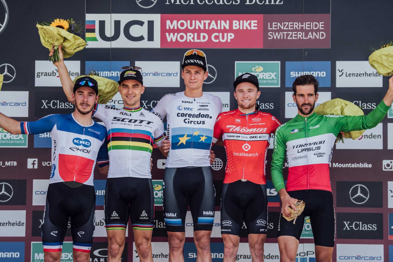 Competitors stand on the podium at UCI XCO World Cup in Lenzerheide, Switzerland on August 11th, 2019
