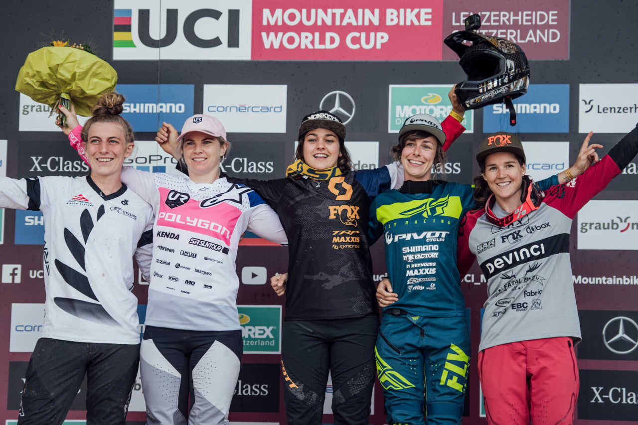 Competitors stand on the podium at UCI DH World Cup in Lenzerheide, Switzerland on August 10th, 2019