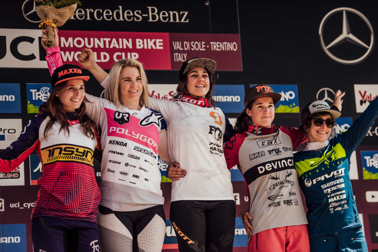 Competitors stand on the podium at UCI DH World Cup in Val di Sole, Italy on August 3rd, 2019 /