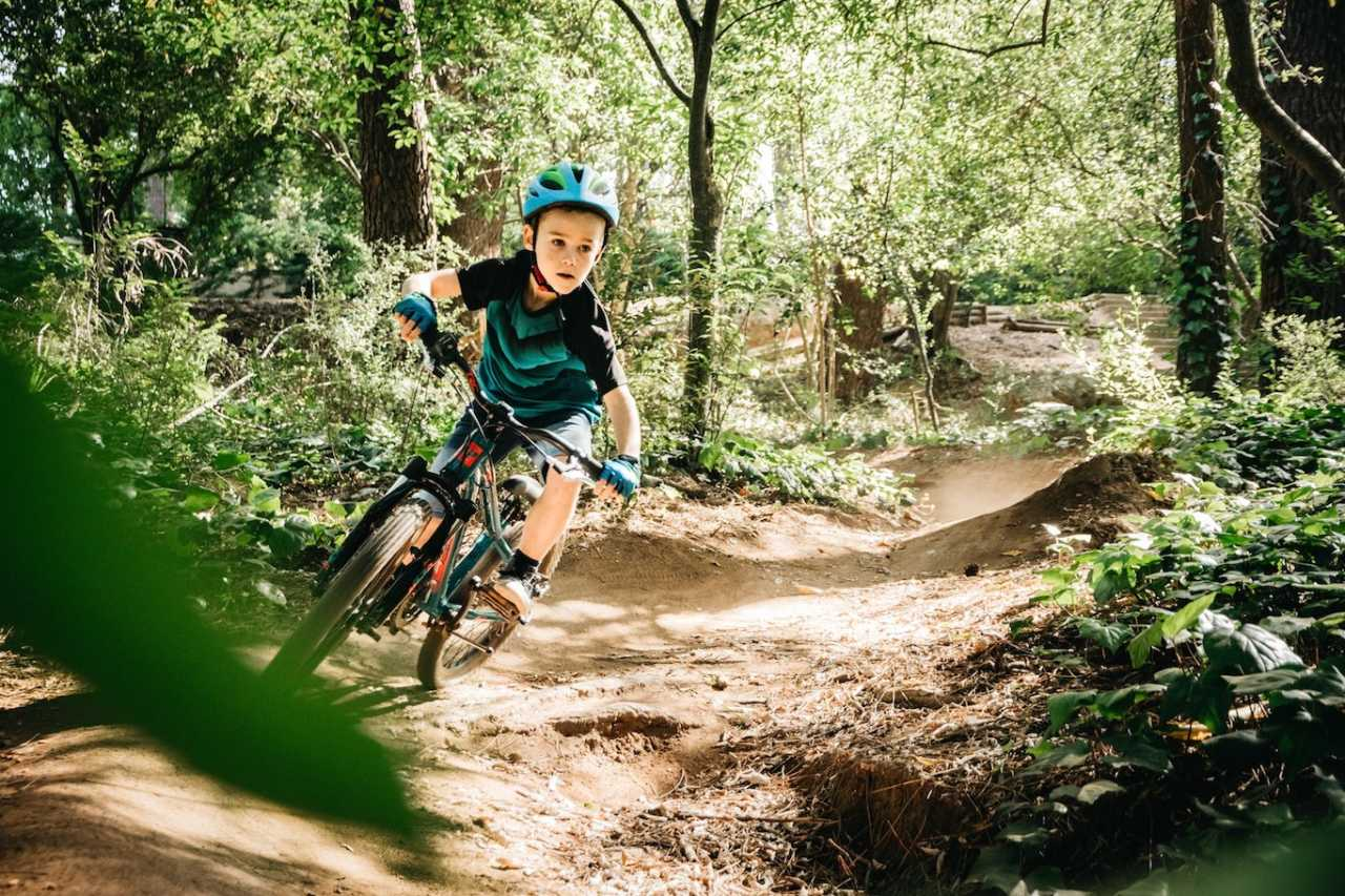 luke futter rides his titan racing bike through the forest in cape town south africa.