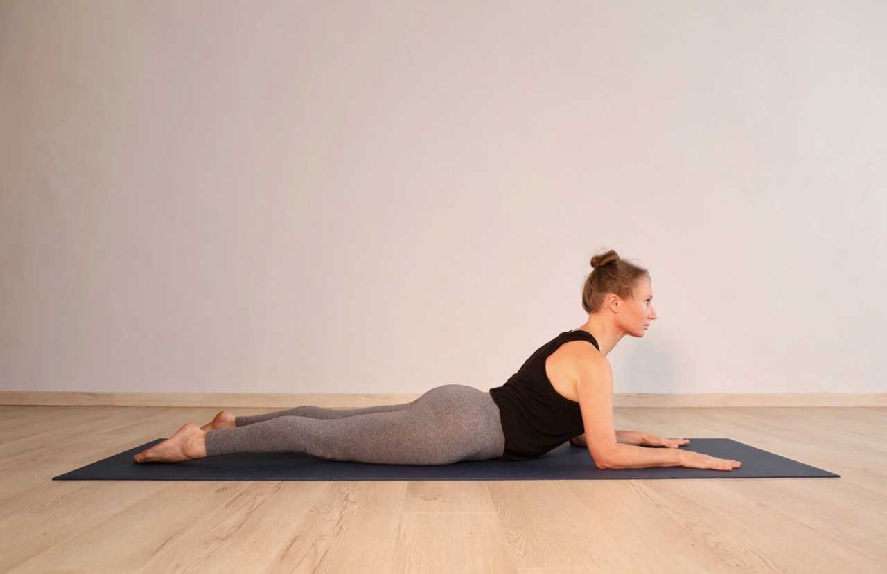 Sphinx yoga pose by Sheona Mitchley for Bike Network.