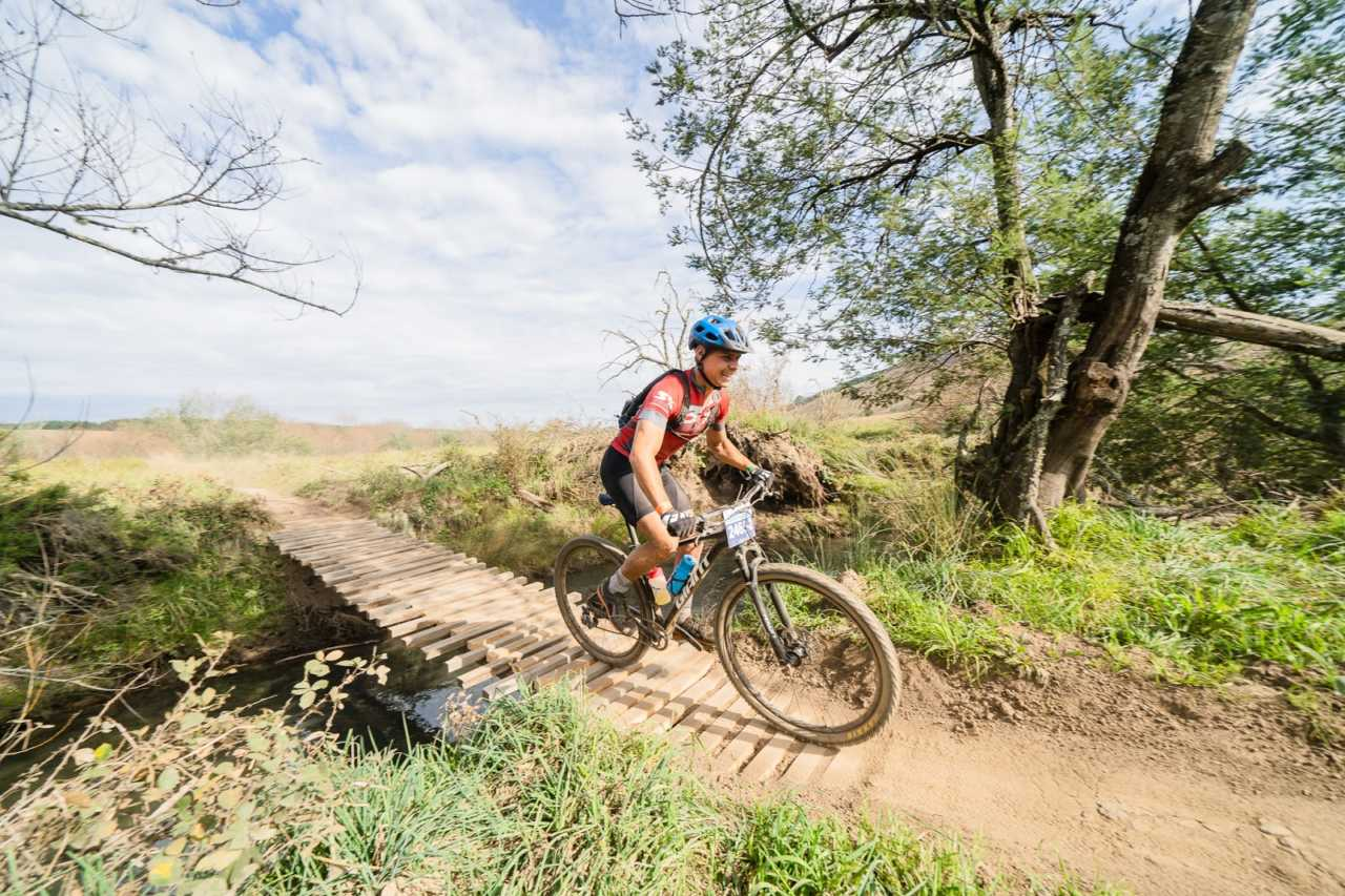 Riders in action at the 2019 kap sani2c 3 day mountain bike stage race from sani pass to the south coast of kwa-zulu natal.