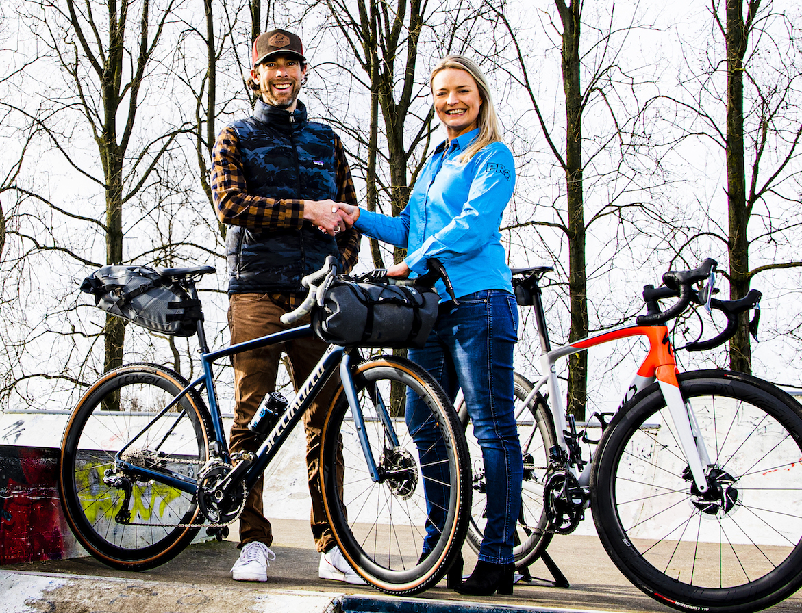 Laurens Ten Dam and Alexa Cunningham shake hands at the Shimano head office in the Netherlands.