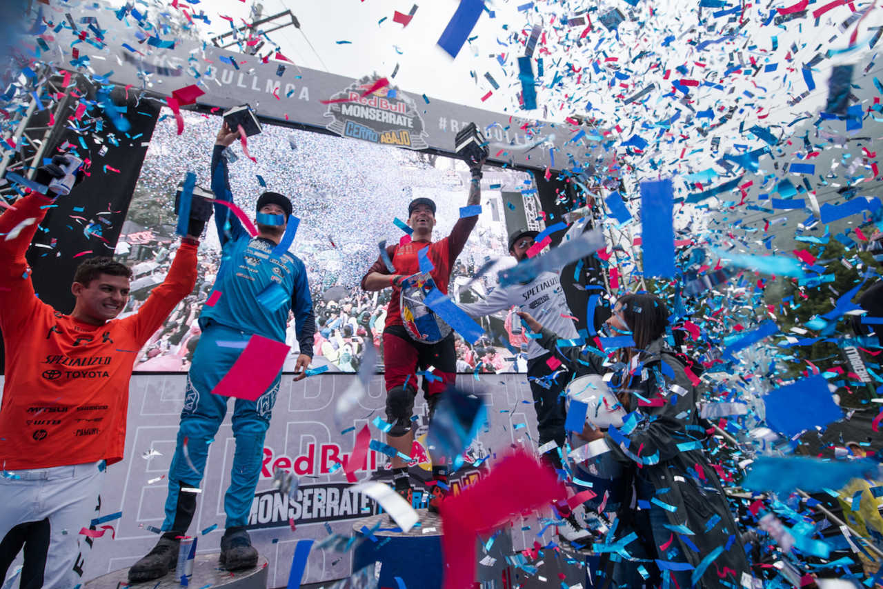 Tomas Slavik and participants celebrate the winner's ceremony at the Red Bull Monserrate Cerro Abajo 2020 in Bogota, Colombia on February 22, 2020.