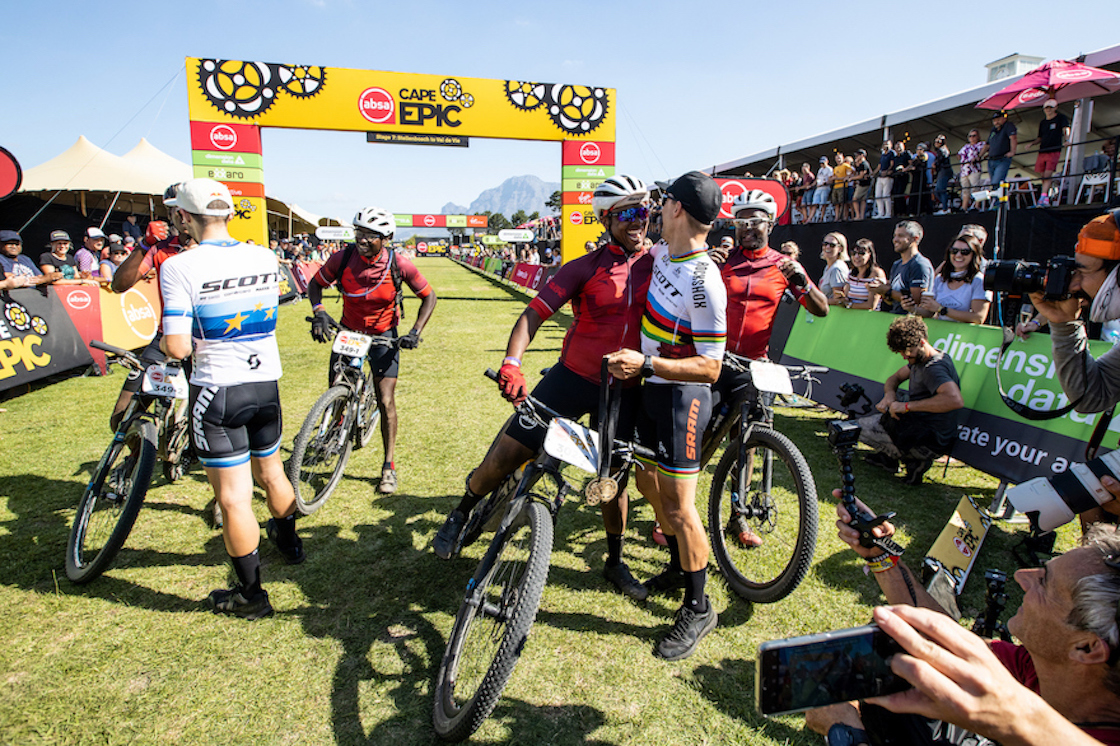 Race winners Nino Schurter and Lars Forster congratulate all the riders at the finish line of the 2019 Cape Epic mountain bike race in Stellenbosch South Africa