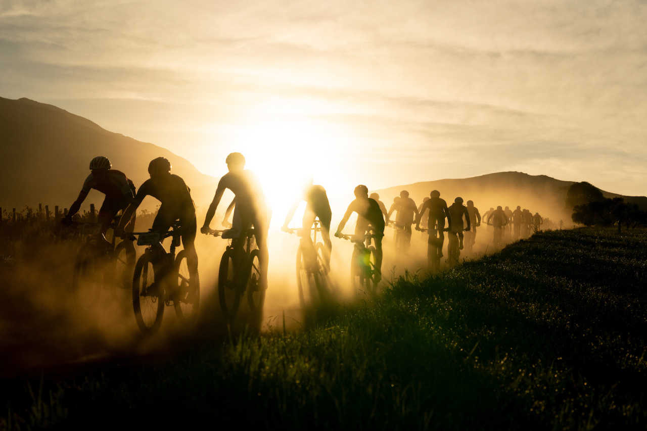 A pack of riders at the Cape Epic mountain bike stage race head out into the mountains of Hermanus