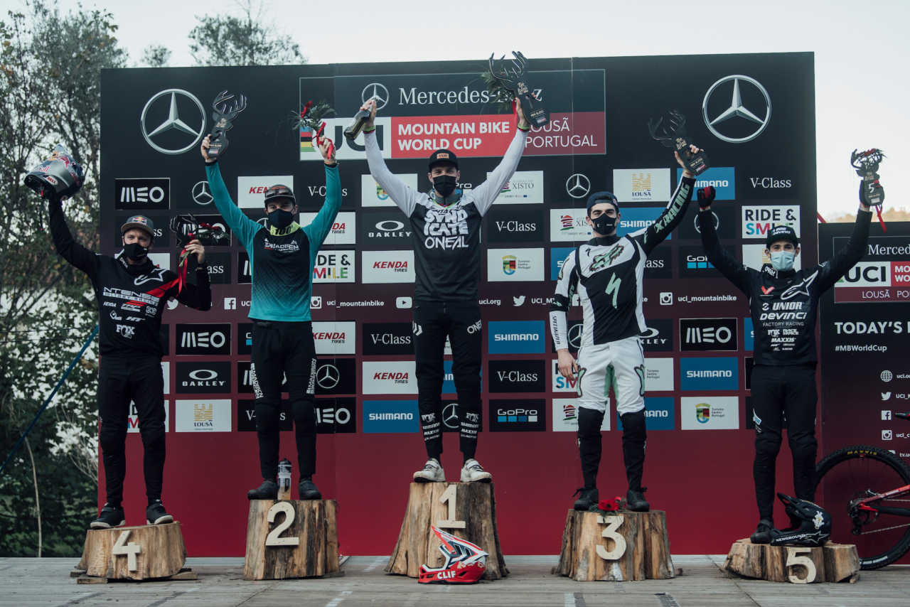 Competitors stand on the podium at UCI DH World Cup in Lousa, Portugal on October 30th, 2020