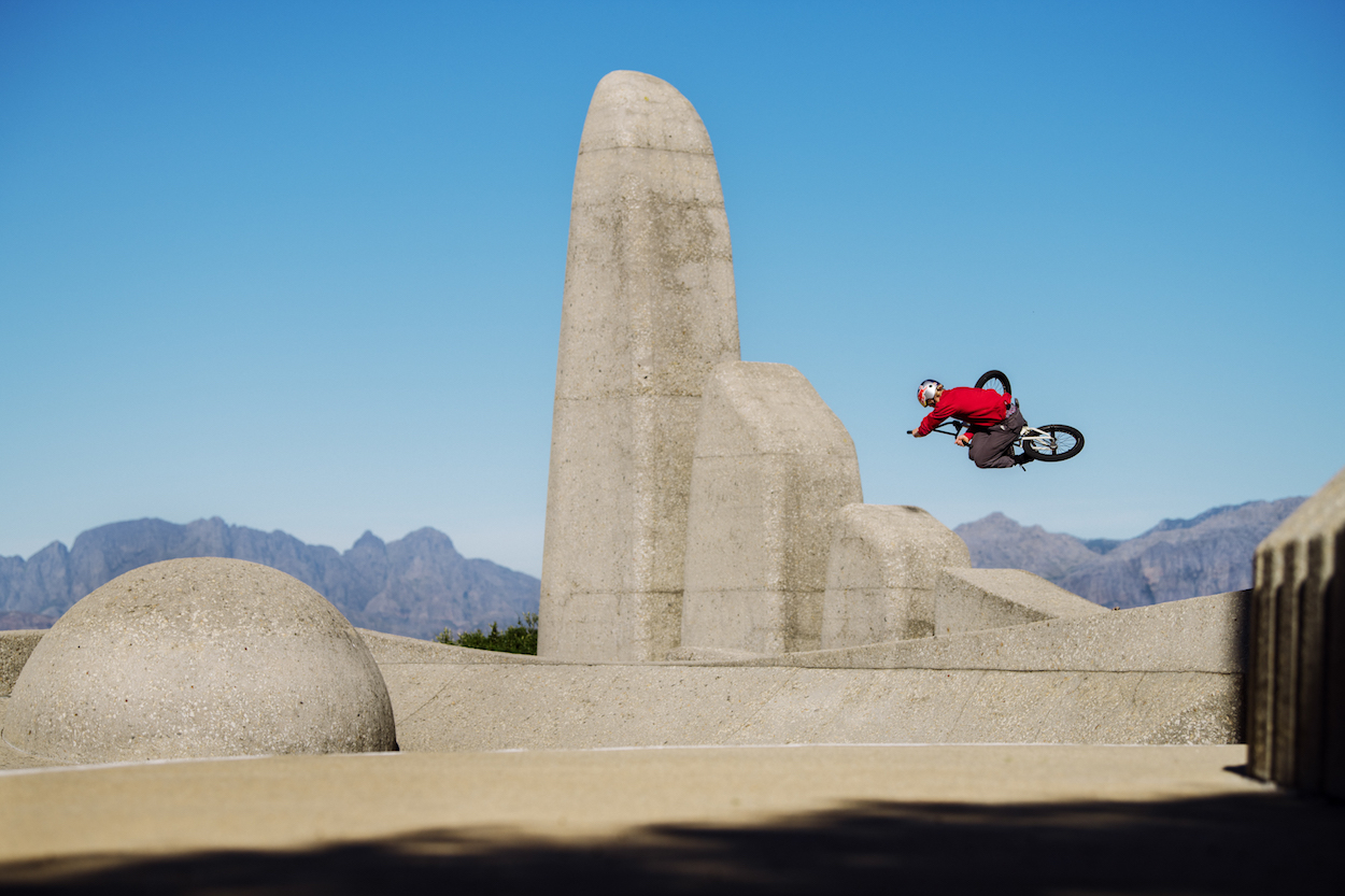BMX freestyle rider Murray Loubser sessions Taal Monument  near Paarl mountain